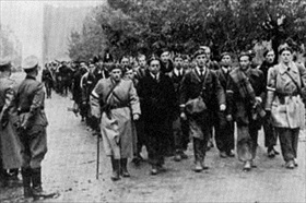 Polish Home Army soldiers march into captivity, Warsaw, October 5, 1944