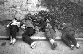 Romanian Holocaust: Collapsed wounded on Bucharest street, Romania, January 23, 1941