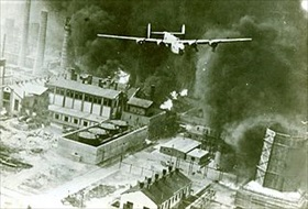 Allied bombing campaign against Axis: B-24 Liberator muscles through smoke columns and cracking towers, Ploesti, August 1, 1943