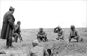 Romanian soldiers with Soviet POWs, June 1942