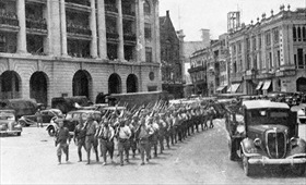 Victorious Japanese infantry march through downtown Singapore