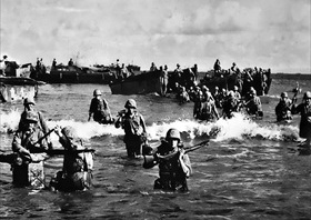 Marines wading ashore on Tinian, 1944