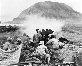 Battle of Iwo Jima: Firing on Japanese cave positions