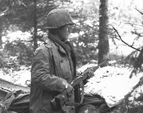 442nd squad leader on alert, France, late 1944