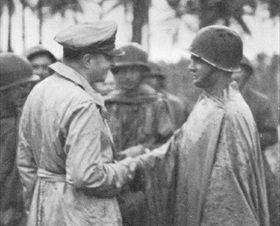 MacArthur decorating the first soldier on Los Negros, February 29, 1944