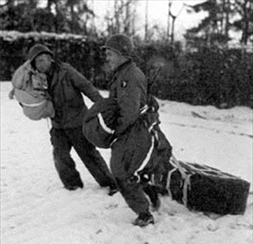 Battle of the Bulge: Soldiers retrieve air-dropped medical supplies, Bastogne, December 1944