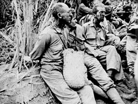 Japan invades Philippines: Bataan Death March POWs, c. May 1942