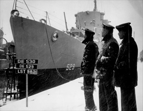 Black crew members of USS Mason on day of ship's commissioning, Boston, March 20, 1944