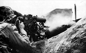 Battle of Iwo Jima: A Marine fires Browning M1917 machine gun at Japanese position