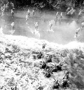Marines wade ashore at Cape Gloucester, New Britain, December 26, 1943
