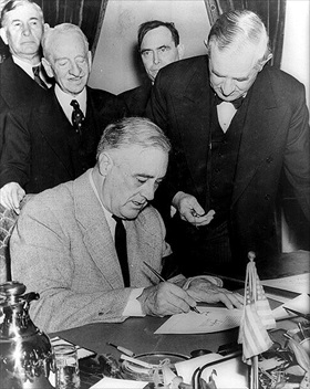 Roosevelt signing declaration of war on Germany