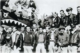 Flying Tiger personnel with P-40 Warhawk, China, February 1943