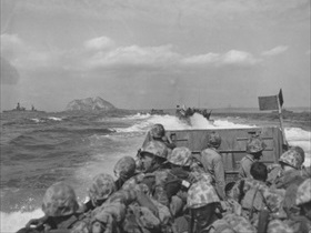 Tracked landing vehicles approach Iwo Jima beaches