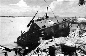 Disabled Landing Vehicle Tracked (LVT) at beach baracade on Red Beach 1, Battle of Tarawa
