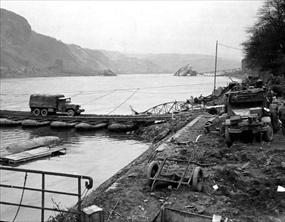 Temporary pontoon bridge and destroyed Ludendorff Bridge, March 1945