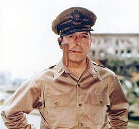 Gen. Douglas MacArthur (1880–1964) with corncob pipe