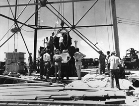 Explosives being readied for hoisting, Trinity site test tower, New Mexico, July 1945