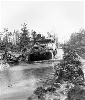 Half-track negotiates muddy road, Huertgen Forest, February 1945