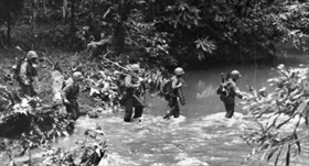 New Georgia Campaign: Marines Raiders cross a stream near Enogai Point