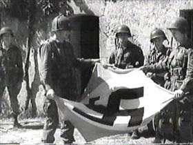 Battle of Carentan: Men from 101st Airborne display captured German flag