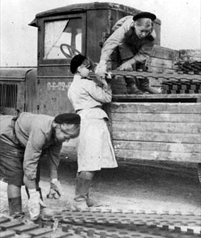 Operation Frantic: Red Army women laying pierced-steel matting at Poltava