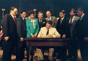 President Reagan signs 1988 Civil Liberties Act
