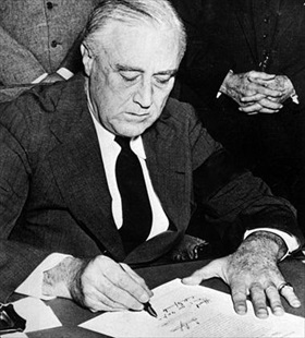 Roosevelt signing declaration of war against Japan, December 8, 1941