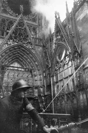 Daylight precision bombing: Rouen cathedral burning, 1944