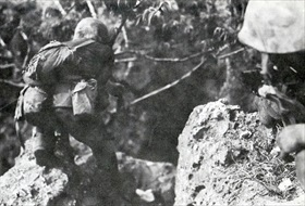 Marine with pistol, Saipan 1944