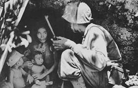 Marine and Chamorro family, June 1944