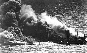 "USS &Dixie Queen"" burning after U-boat attack, March 26, 1942"