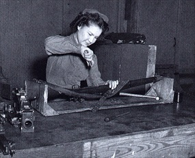Women's Army Corps (WAC) armorer repairs rifle, Camp Campbell, Kentucky