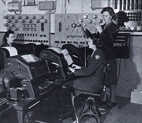 Women's Army Corps (WAC) servicemembers operate teletype machines on Eighth Air Force base