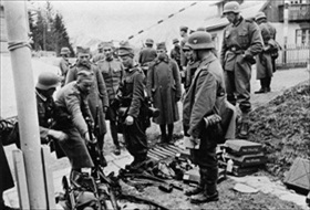 Yugoslav soldiers surrender arms