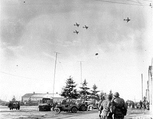 C-47s drop relief supplies, Bastogne, December 26, 1944