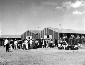 Internees line up for housing and bedding, Tule Lake, July 1942