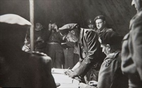 Adm. Friedeburg signing Instrument of Surrender of All German Armed Forces in Holland, Northwest Germany, and Denmark, Lueneburg Heath, May 4, 1945